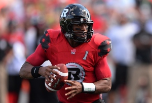 Ottawa Redblacks' Henry Burris lines up a pass as he takes on the Calgary Stampeders during CFL action in Ottawa on Sunday, Aug. 24, 2014. THE CANADIAN PRESS/Sean Kilpatrick