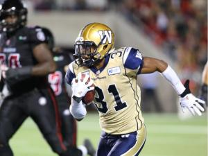 Maurice Leggett of the Winnipeg Blue Bombers goes on to score a touchdown on his punt return against the Ottawa RedBlacks during first half of CFL action at TD Place in Ottawa, October 03, 2014. (Jean Levac/ Ottawa Citizen)