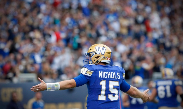 Winnipeg Blue Bombers quarterback Matt Nichols (15) celebrates his touchdown against the Saskatchewan Roughriders during the second half of CFL Banjo Bowl action in Winnipeg Saturday, September 10, 2016. THE CANADIAN PRESS/John Woods